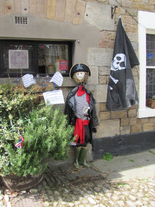 Scarecrow outside the pub